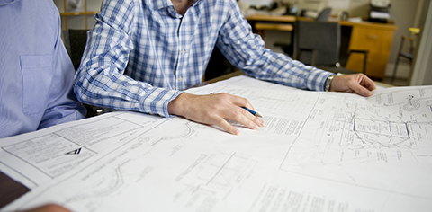 Client looking at plans