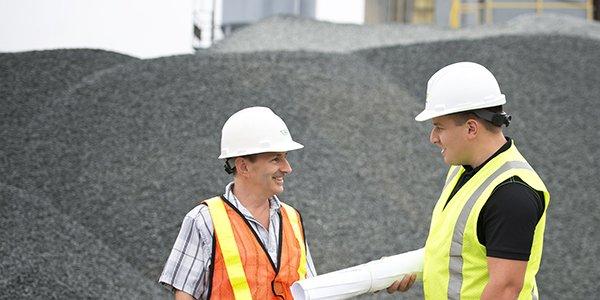 Matt Power with co-worker in the field