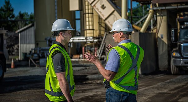 Two construction workers having a conversation.
